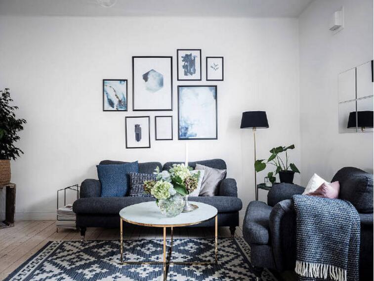 單身公寓樣板房客廳沙發背景墻照片裝修圖片
